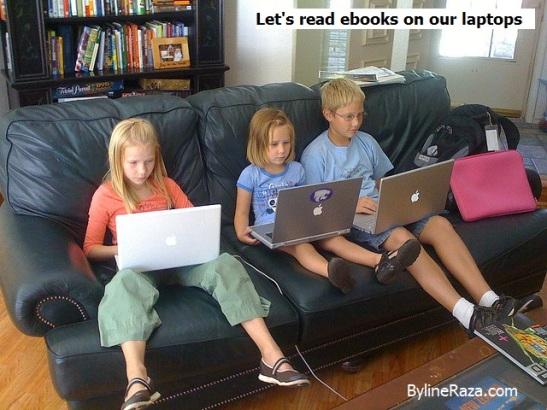 Kids reading ebooks on laptop
