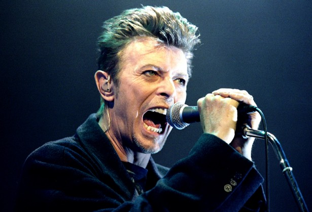 British Pop Star David Bowie screams into the microphone as he performs on stage during his concert ..